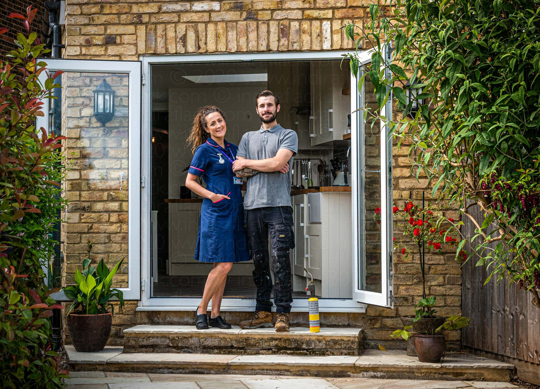 Dan & Bethan neighbours in lockdown portrait taken by Indira Flack portrait photographer